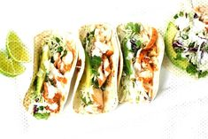 Easy Fish Tacos with Lime Crema: When lime and cilantro come together with fish, a mouthful of exquisite flavour is born. Try these easy fish tacos with lime crema and see for yourself! Fish Tacos With Cabbage, Easy Fish Tacos, Cabbage Slaw, Baked Fish Tacos, Cod Fish Tacos, Healthy Fish Tacos, Salmon Tacos, Sauce For Fish Tacos, Halibut Tacos