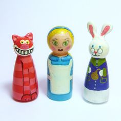 Alice in Wonderland painted dolls. $20.22, via Etsy.