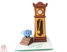 A second birthday cake inspired by the popular Hickory Dickory Dock nursery rhyme.