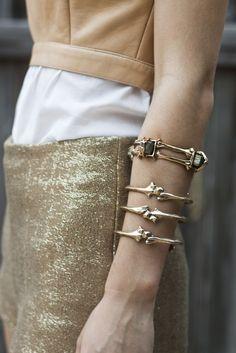 bone-inspired arm cuffs