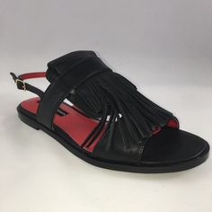 Charles Jourdan Ocean Sandal Brand new never worn. True to size.  - Open toe - Kiltie vamp - Adjustable side buckle strap closure - Imported Materials: Leather upper, manmade sole Charles Jourdan Shoes Sandals
