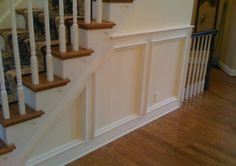 Recessed panel wainscoting under a staircase.