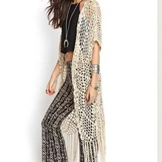 Boho cardigan Oversized boho tassel cardigan. From forever 21, marked as free people for views Free People Sweaters Cardigans