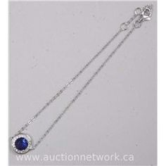 Ladies .925 Sterling silver Bracelet with Saphire Blue Swarovski elements. - Auction Network