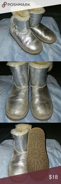 Ugg boots for little girls Silver in color, one button on the side, need some cleaning but have plenty of life left in them for the price UGG Shoes Boots