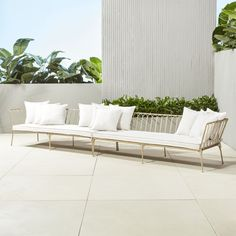 Shop le rêve gold sectional sofa left arm.   Elegant gold daybeds combine to create a sectional worthy of the poshest patios.  Slim iron frame is welded and formed by hand into graceful looped design.