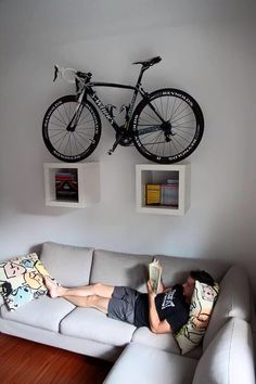 bike storage ideas and modern interior design Here is a collection of space-saving bike storage ideas that give sports enthusiasts great inspirations and help decorate their home interiors in a unique, sport-inspired, and creative style Hanging Bike Rack, Bike Hanger, Hanger Rack, Bicycle Wall Mount, Bicycle Art, Bicycle Stand, Bike Mount, Bike Storage Apartment, Velo Design