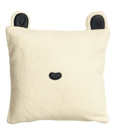 Cushion cover in soft pile with ears and appliqués in imitation leather and a concealed zip. Size 16 x 16 in.