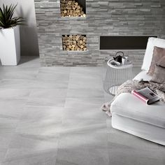 Minoli Tiles - Stockholm - How contemporary could a stone effect tile like Stockholm be? Look at this Stockhom Lysgrau by Minoli in your living area. Floor Tiles: Stockholm Lysgrau 60 x 60 cm/ Wall Tiles: Stockholm Lysgrau Spaccatella 10.5 x 45 cm - http://www.minoli.co.uk/tiles/stockholm/ - http://www.thesurfacewithin.co.uk/range/stockholm/lysgrau-2 - #stoneeffect #stonelook #stone #effect #look #grey #porcelain #tiles #Stockholm #Minoli