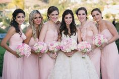 pink long bridesmaid dress with everyone in a different style...this is exactly what I want!