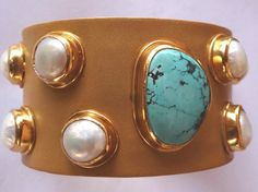Gold plated sterling silver cuff in matt finish with natural turquoise tumble and fresh water pearls. Hand made in India. www.mynahstree.com
