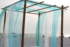 palm tree arbor for wedding | Turquoise Beach Bamboo Wedding Structure