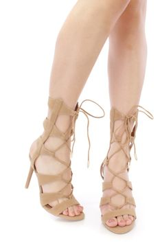 These sexy and stylish single sole gladiator heels are a must have this season! The features include a faux suede upper in a strappy design with a front lace up tie design, open toe, smooth lining, and cushioned footbed. Approximately 4 1/2 inch heels.
