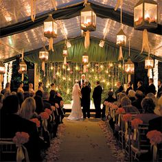 Brides.com: Melanie and Scott in Houston, TX The candlelit ceremony was held in a clear-top tent set up over the pool. Lanterns filled with pink roses hung from the ceiling, and each aisle seat was decorated with a bouquet of pink roses.Bride: Melanie FrenchGroom: Scott RothwellLocation: Houston, TX