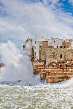 Stormy sea over the wonderful village of Polignano in south of italy