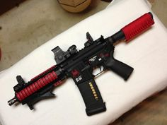 """Spikes Tactical 7.5"""" with MOE grip, strike industries angled fore grip, MBUS sights, Sightmark red dot, and great red accents"""