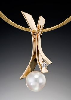"An exquisite pearl blooms forth from graceful petals of gold.  Fiore Del Mare pendant feautres a 13mm (approx.) white South Sea Pearl in 14kt yellow gold with a .25 carat VS G accent diamond. The pendant is shown on 14kt yellow gold 10-strand necklace available in 16"", 18"", and 20"". Please click inquire to begin."