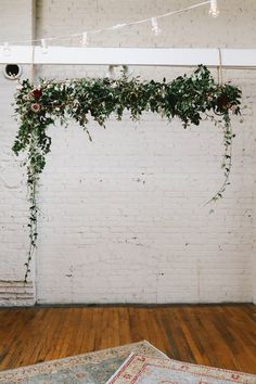floral ceremony backdrop - photo by w&e photographie http://ruffledblog.com/sentimental-loft-wedding-in-birmingham
