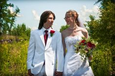 White bride and groom with a hint of red