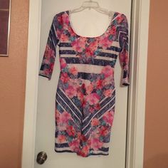 Multi colored above knee lace dress. Beautiful,  Multi colored knee length dress. Mid sleeve multi colored lace sleeve. Tried on but never worn. Very thin to me as it lace, with thin inner slip. Cannot wear due to mastectomy. Venus Dresses High Low