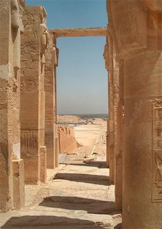 """Hathor Chapel, Middle Terrace. Pillar to the right shows a Hathor epithet """"Chief of Thebes"""" I believe the full text is """"Beloved of Hathor, Chief of Thebes"""". Part of the very heavy Hathoric wig can be seen at the top of the pillar."""