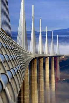 The Millau Viaduct in southern France, is the tallest bridge in the world. It's a cable-stayed bridge that spans the valley of the River Tarn near Millau in southern France. Places To Travel, Places To See, Scary Bridges, Beautiful Architecture, Bridges Architecture, France Travel, Belle Photo, Wonders Of The World, Places