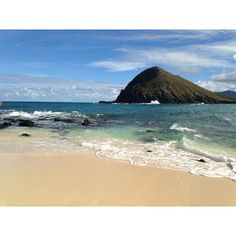 """The Mokulua Islands, commonly referred to as the """"Mokes"""", are just a paddle away from Lanikai Beach."""