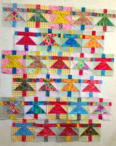 This gorgeous Paper Dollies by Brandon Mably is a great child's quilt or a fabulous wall hanging for a person, like me, who remembers making and playing with papers dollies.