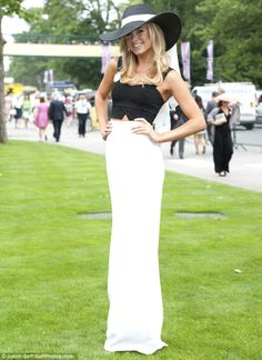 Monochrome magic: Kimberley Garner made sure she dressed to impress as she headed out to Ladies' Day at Royal Ascot at Ascot Racecourse in Berkshire on Thursday