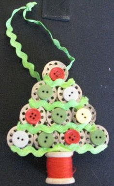 Tree ornie made using bobbins, spool, & buttons - CUTE!