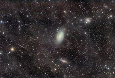 M81 Galaxy Group. Through the Integrated Flux Nebula  (Image Credit : Nicolás Villegas) Large galaxies and faint nebulae highlight this deep image of the M81 Group of galaxies. M81 is acting gravitationally with M82, which is just below it with a red bulge at its center.