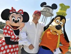 Actor Bruce Willis poses with Minnie Mouse and Goofy near the mouse-eared water tower at Disney's Hollywood Studios theme park on Feb. 27, 2011. Willis has been visiting Disney World with family and friends.
