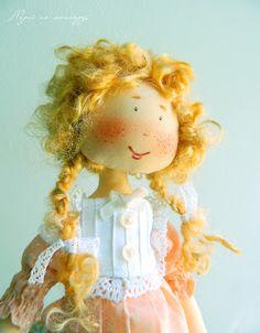que cosita tan graciosa , me recuerda a  una mandarina.Dreams in the attic