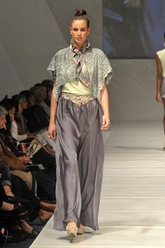 palazzo pants with ripped fabric and button detail, paired with a guipure lace shawl