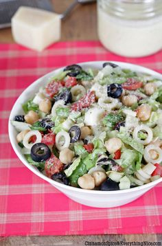 Chopped Italian Salad -- loaded with tasty ingredients like pepperoni and chickpeas, salami and -- hearts of palm?  (i'd add those) and artichokes and olives -- all with a tangy parmesan vinaigrette.  YUM!