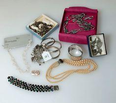 Lot 72 - A silver charm bracelet, the curb pattern bracelet suspending numerous silver and white metal