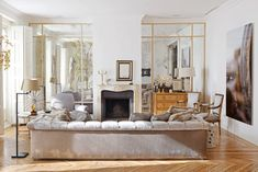 LUIS PUERTA | Mirrors - gorgeous mirrors flanking the fireplace in the living room