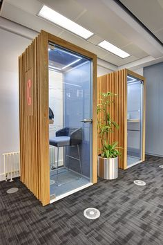 Office private phone booths with cladding, 'in use' signs, lighting and tables. Office Space Design, Workspace Design, Office Workspace, Office Interior Design, Office Fit Out, Future Office, Open Office, Office Style, Corporate Interiors