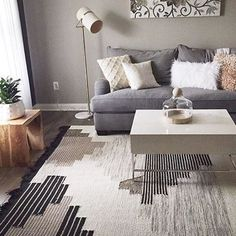 West Elm Handwoven Colca Wool Rug $899 - geo-tribal aztec print pattern, earthy tones, neutral palette accented with bronze threading