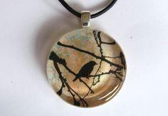 Crow, Blackbird, Bare Tree - Glass Pendant with Leather Cord, via Etsy.