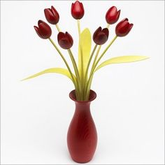 Red Tulips in Classic Red Vase