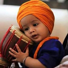 Waheguru jio  sikh toddler orange turban  boy india