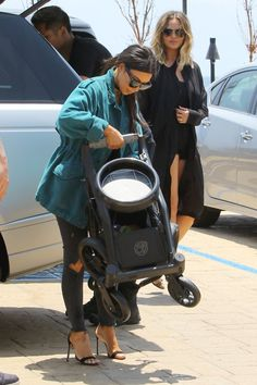 Pin for Later: New Mums Chrissy Teigen and Kim Kardashian Share a Sweet Hug in LA