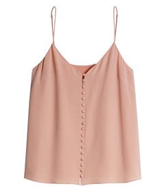 If layering is the key to building a wardrobe that works well together, consider simple silk camisoles the foundation.  For a cami that's pretty (and dressy) enough to become more than an underpinning, look for dressy details like this version's button-front placket.