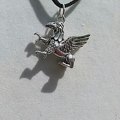 """Gryphon Necklace Pendant is approx 1"""" x 1 1/4"""" Tibetan silver. On 18"""" black cord with lobster catch.  NWOT , gift boxed. Jewelry Necklaces"""