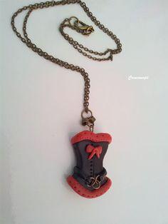 Pendentif Steampunk en porcelaine froide corset http://www.alittlemarket.com/pendentif/fr_pendentif_steampunk_porcelaine_froide_corset_rouge_et_noir_sur_chaine_metal_bronze_-17068782.html (vendu)