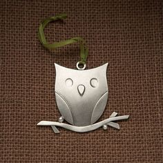 an owl ornament on Etsy.  sold... :(  http://www.etsy.com/listing/61485244/owl-ornament