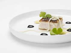 """wild sea bream, young almond """"noodle"""" squid ink-olive oil emulsion, oxalis"""