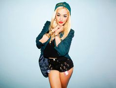 Rita Ora wears skullcap by The Hundreds; jacket by Moschino, vintage; silk crop top by Pavonine; shorts by Joy Rich; custom shoes by Bess NYC; necklaces and watch are Rita's own; bangle by Laruicci; double ring by Materia Prima.