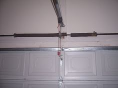 Garage door garage door torsion spring adjustment home for Broken garage door spring repair cost